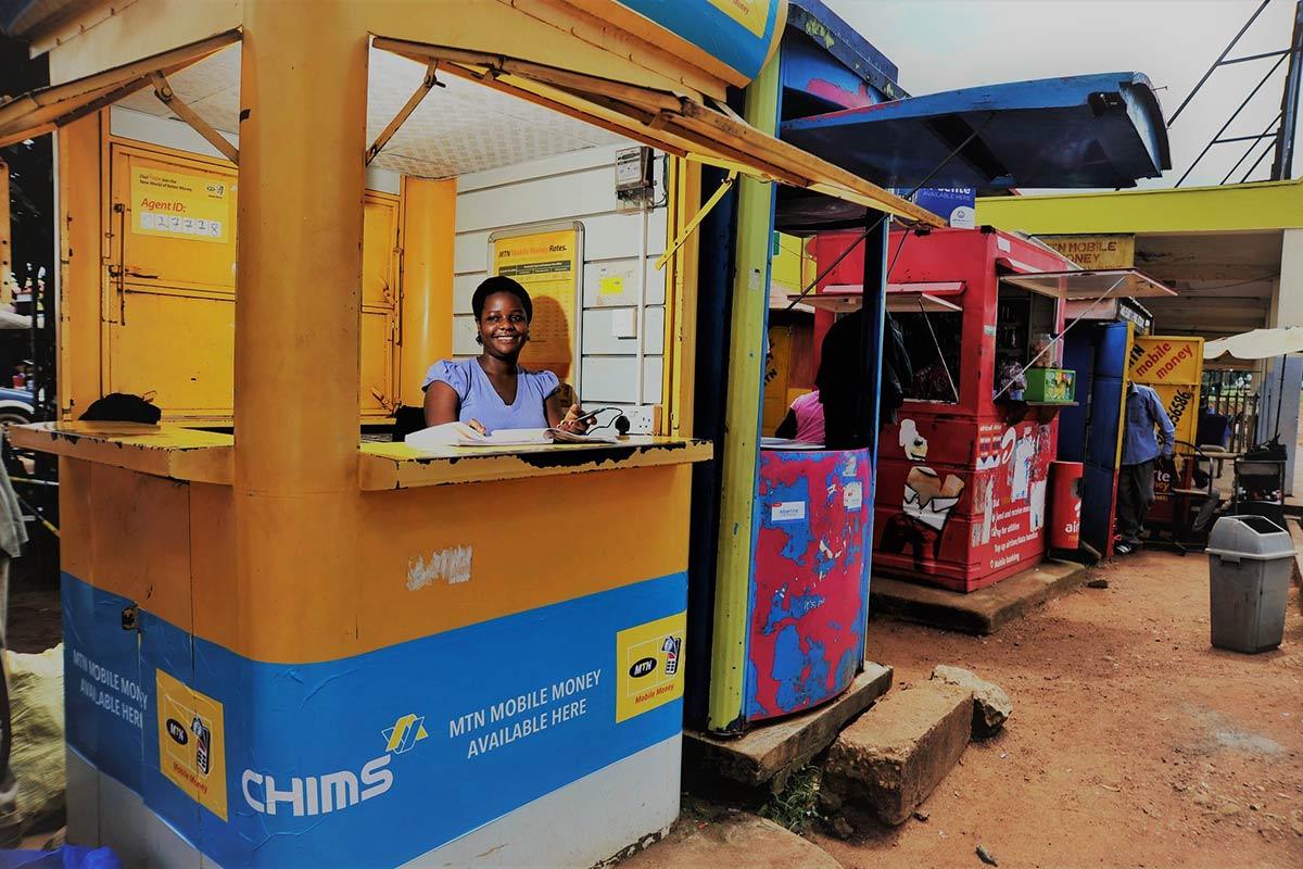 Mobile money kiosks in Entebbe. JosephineNamugenyi, 30, working in her kiosk selling airtime and mobile money.