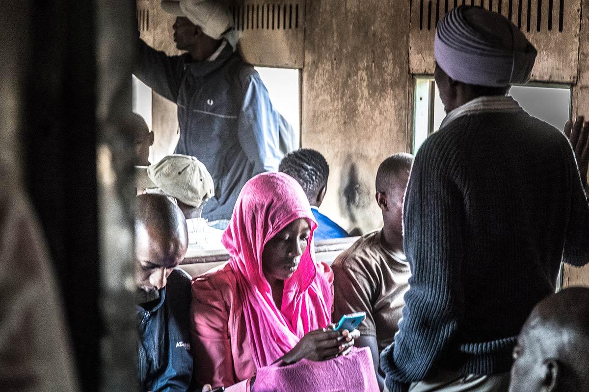 Media & Communication in Uganda: Woman in red hood